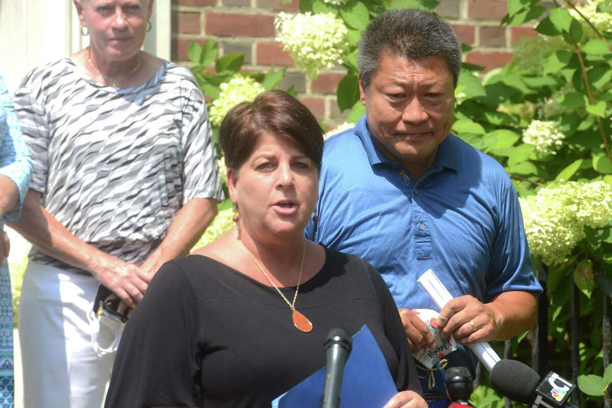 Dawn Parker, Director of UniteCT for the Connecticut Department of Health, speaks during a news conference in front of Operation Hope, in Fairfield, Conn. Aug. 30, 2021.