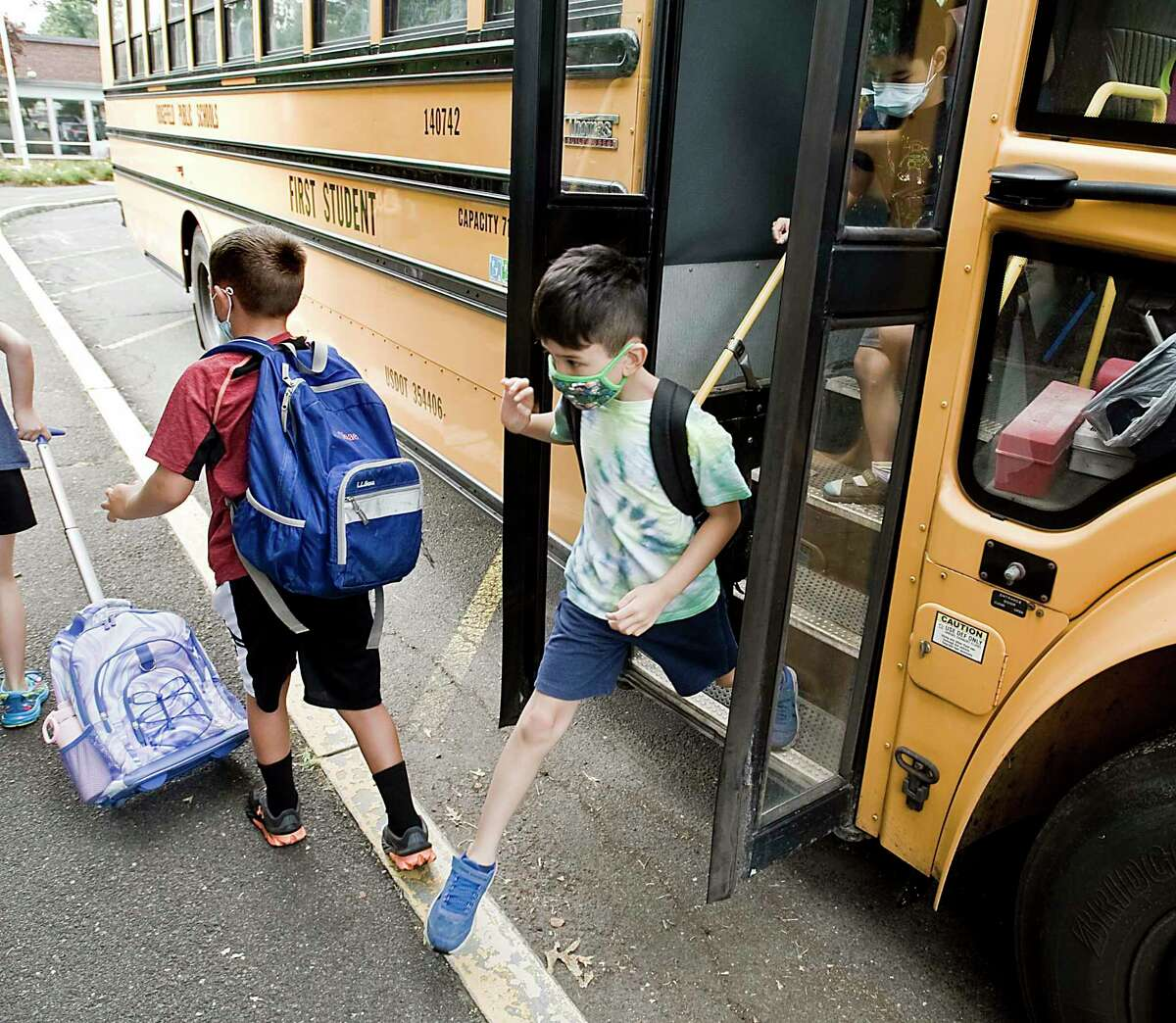 Children arrive for the first day of school at Veterans Park Elementary in Ridgefield. Monday, Aug. 30, 2021.