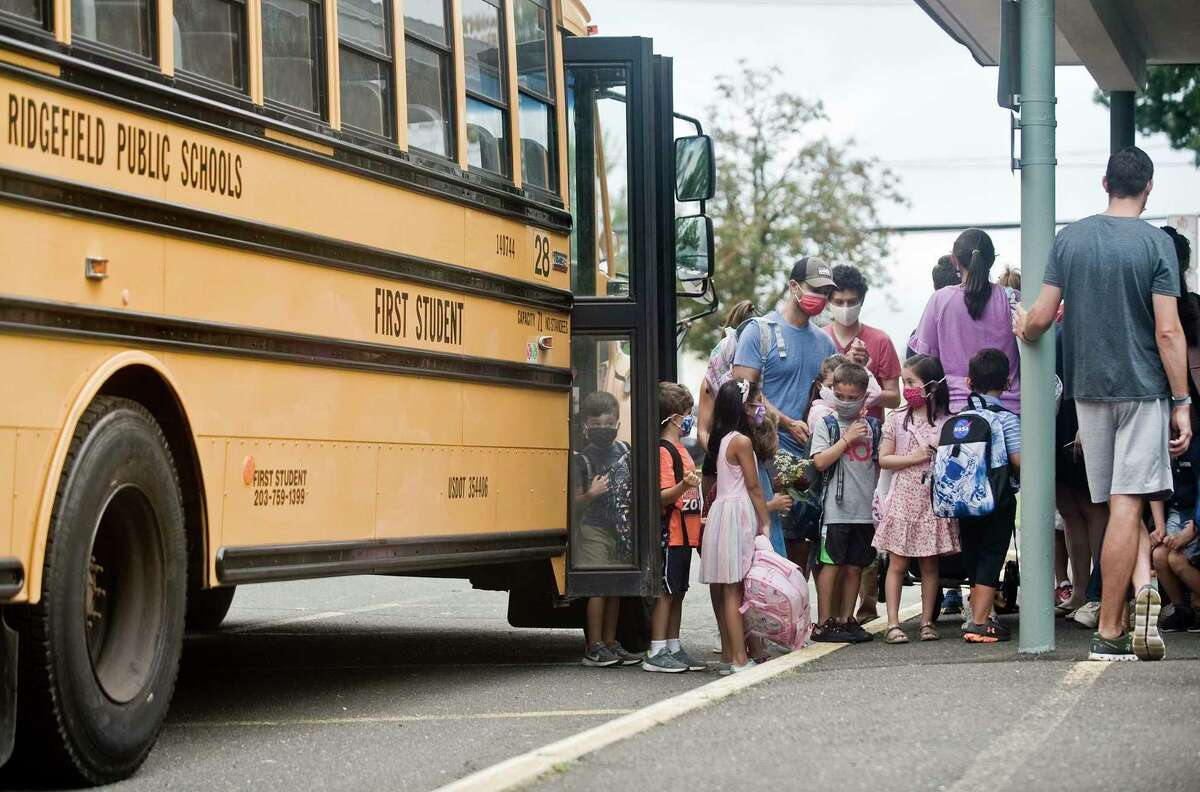 Parents and children arrive for the first day of school at Veterans Park Elementary in Ridgefield. Monday, Aug. 30, 2021.