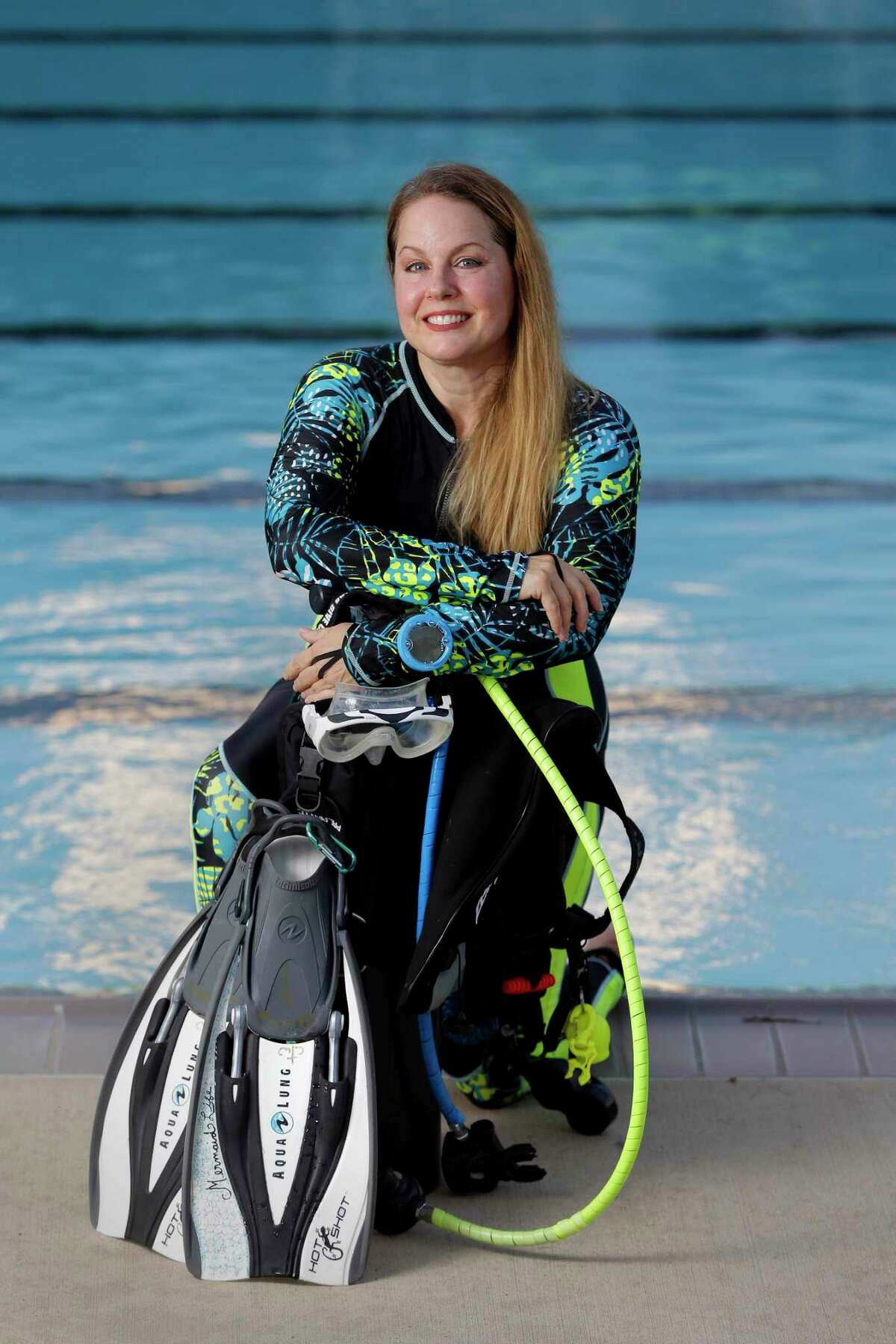 Caroline Wolbrecht, an avid scuba diver, at the Dow Park swimming pool near her home Wednesday, Aug. 25, 2021 in Deer Park, TX. Wolbrecht thought she had skin bends which would end her diving. It turned out to be a condition known as PFO, which she had corrected through surgery, allowing her to continue diving.