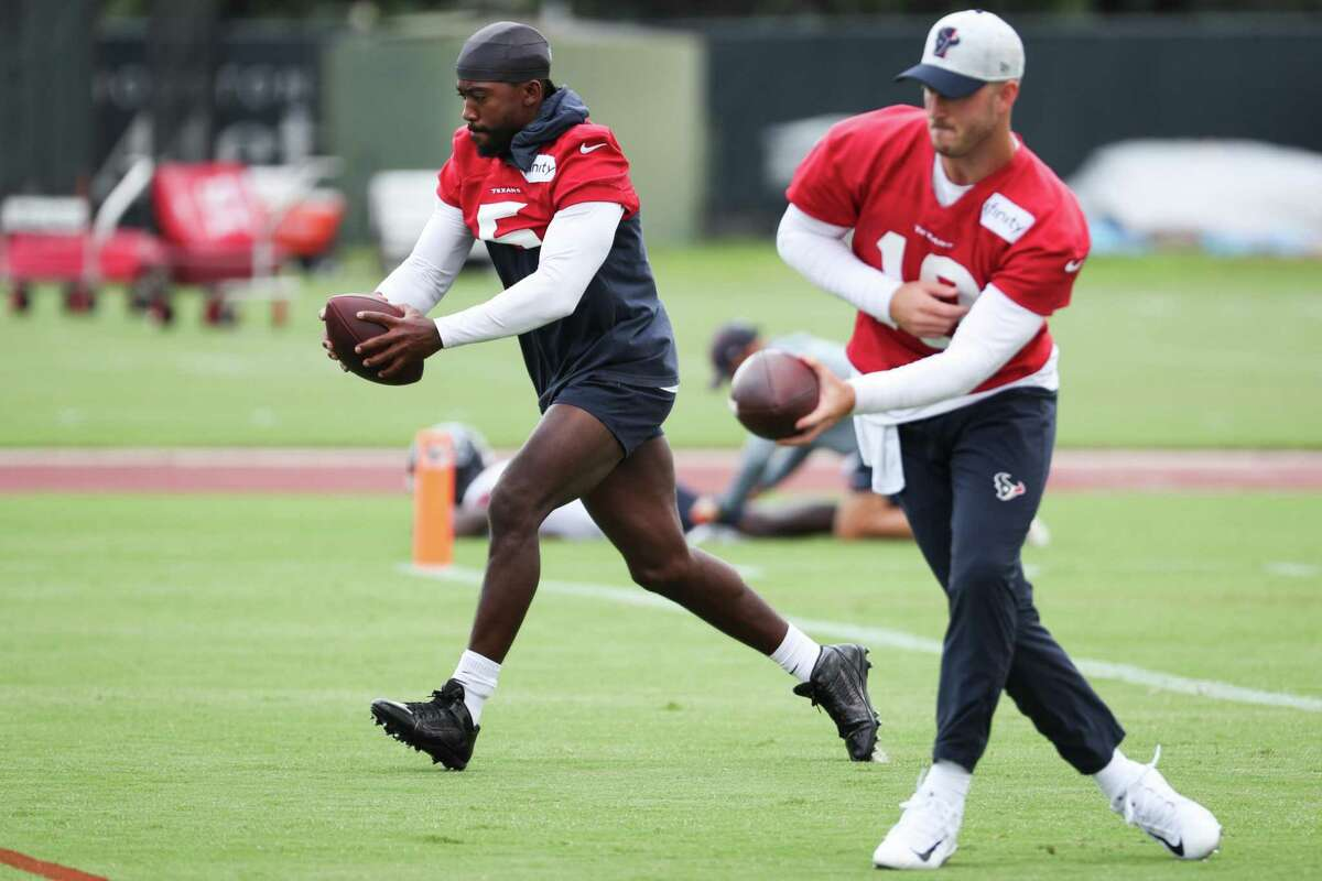 In the wake of Deshaun Watson's legal woes, Tyrod Taylor (5) has been handed the Texans' quarterback job, with rookie Davis Mills (10) his backup.