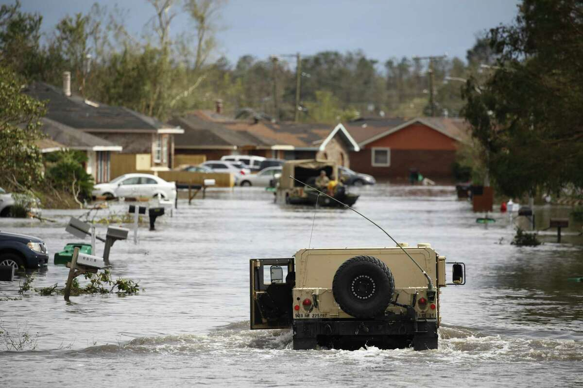 A National Guard vehicle drives through floodwaters in LaPlace, La., on Monday in the aftermath of Hurricane Ida.