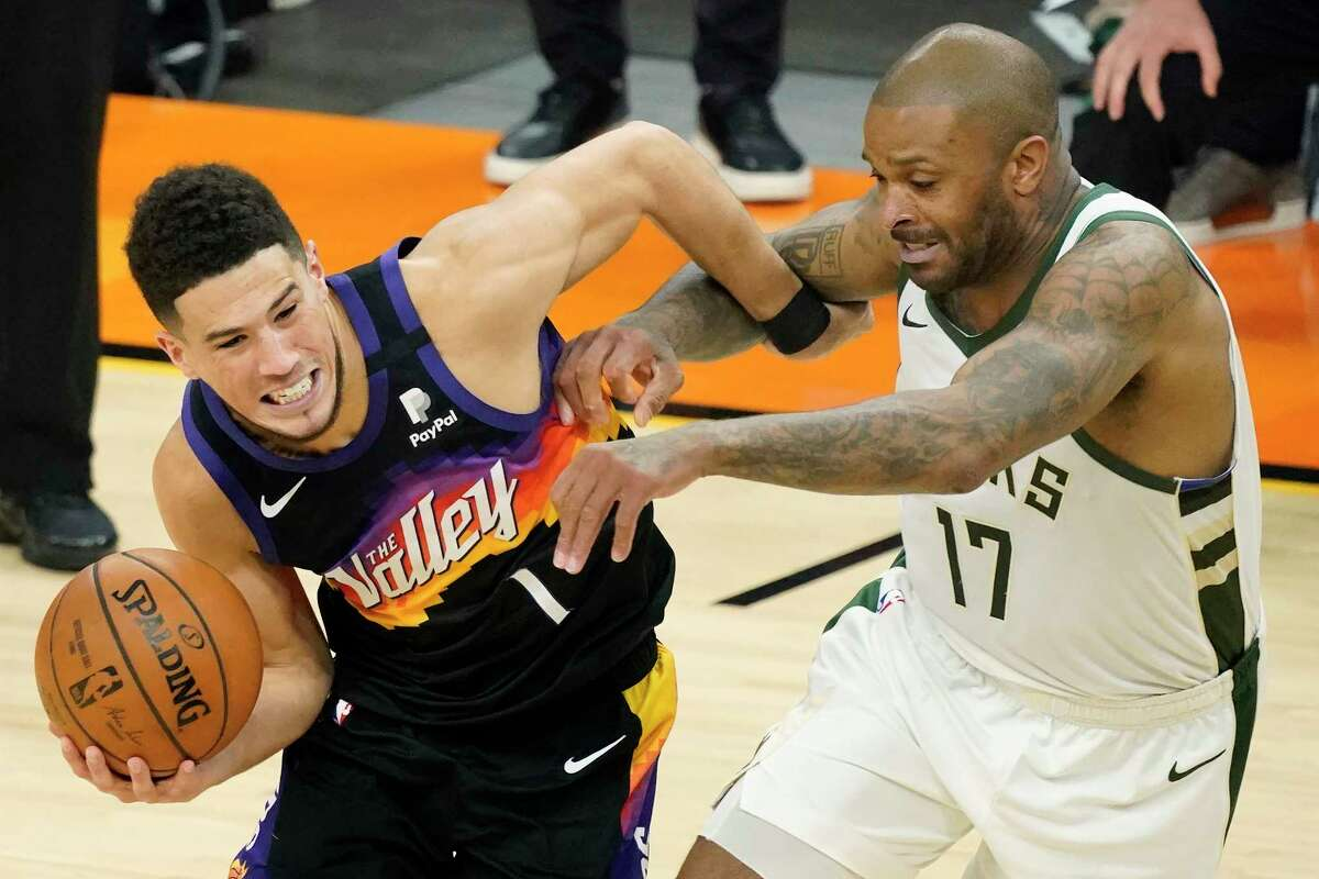 After helping Milwaukee end a 50-year championship drought after his trade from the Rockets, P.J. Tucker (right) is taking his talents to South Beach after signing with Miami as a free agent.