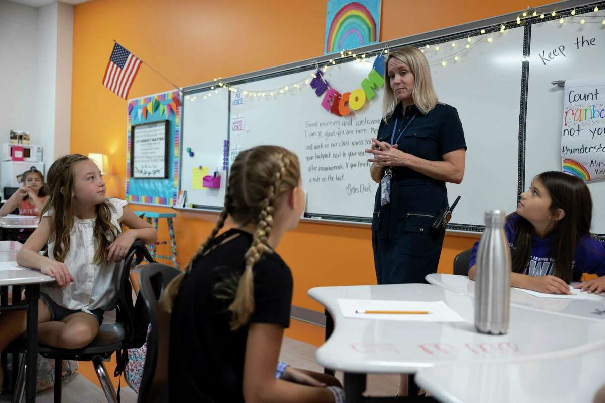 Kameron Wilder, principal of Eddie Ruth Lagway Elementary, speaks to a classroom during the first day of school at Eddie Ruth Lagway Elementary on Aug. 11. The 101,930 square foot two-story building will house 850 kindergarten through fifth grade students.