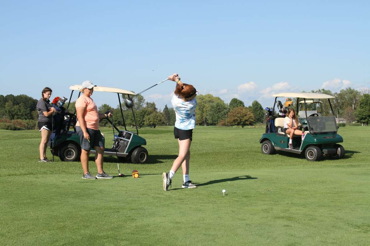 Manistee sophomore Kendal Waligorski gets ready to tee off during practice.