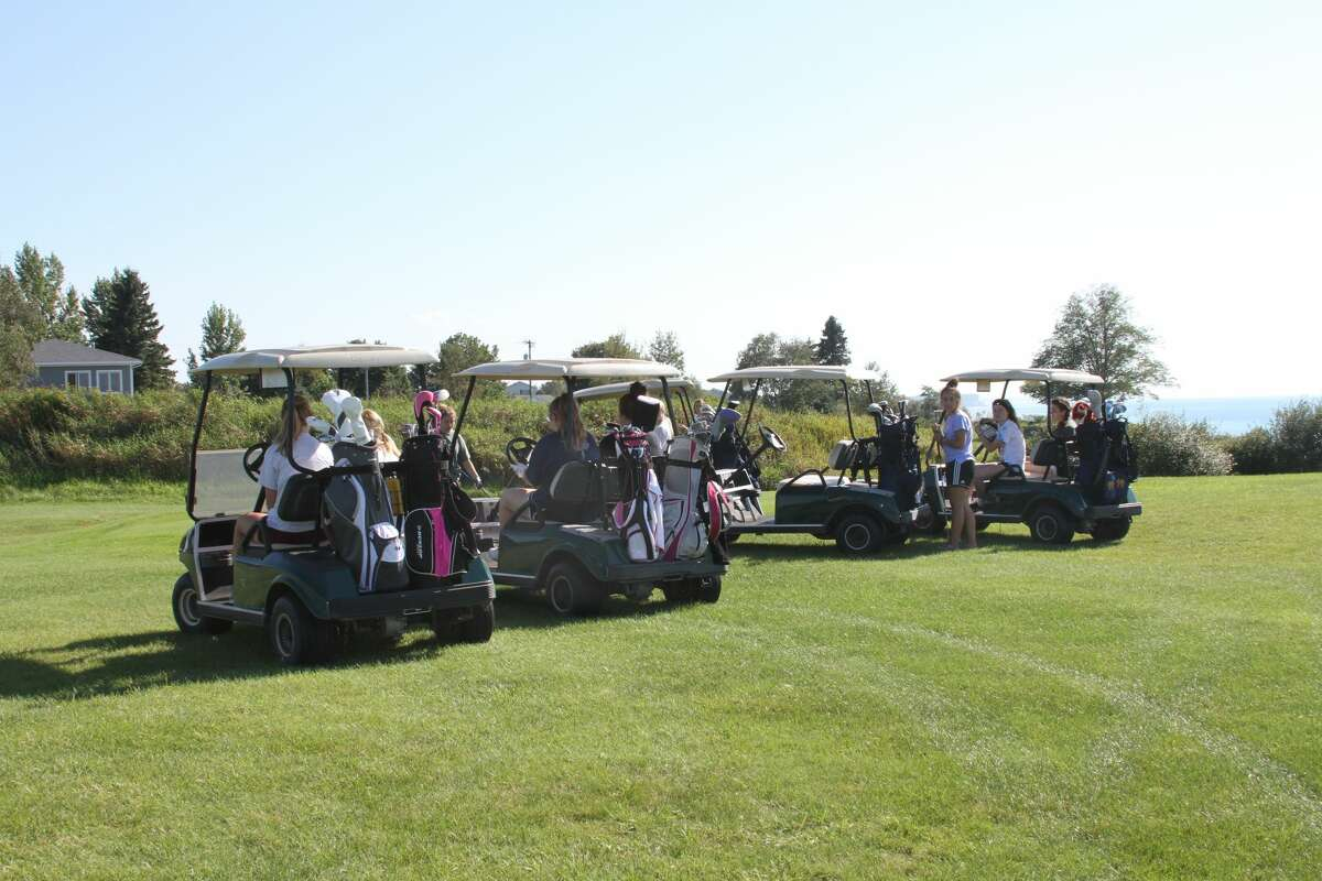 The Manistee girls golf team prepares to practice its chipping on Monday afternoon.