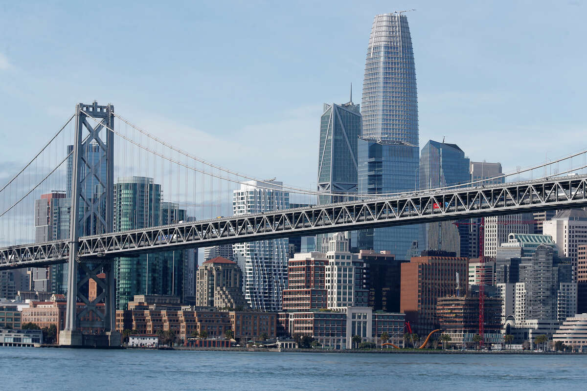 The Bay Bridge and the San Francisco skyline including the Salesforce Tower are seen in this view from the bay.