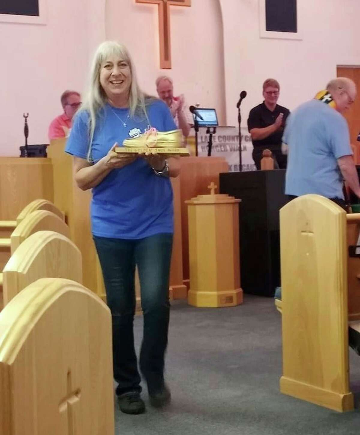 Lynne Mills, of Bread of Life Food Pantry, accepted the Golden Shoe Award. (Star photo/Shanna Avery)