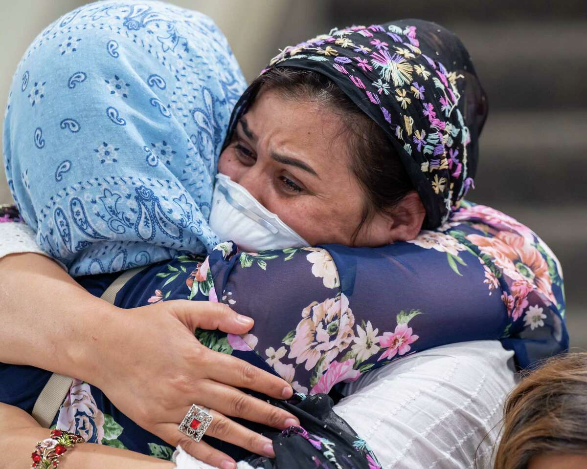 Suneeta, a Capital District-based mom who fled the terror in Afghanistan, hugs a friend at the Albany International Airport. Her four children were stuck in their native country but recently flew into Washington DC and then into Albany on Monday, Aug. 30, 2021. Gov. Kathy Hochul announced Thursday that over 1,000 Afghan refugees are expected to settle in New York in the coming months. (Jim Franco/Special to the Times Union)
