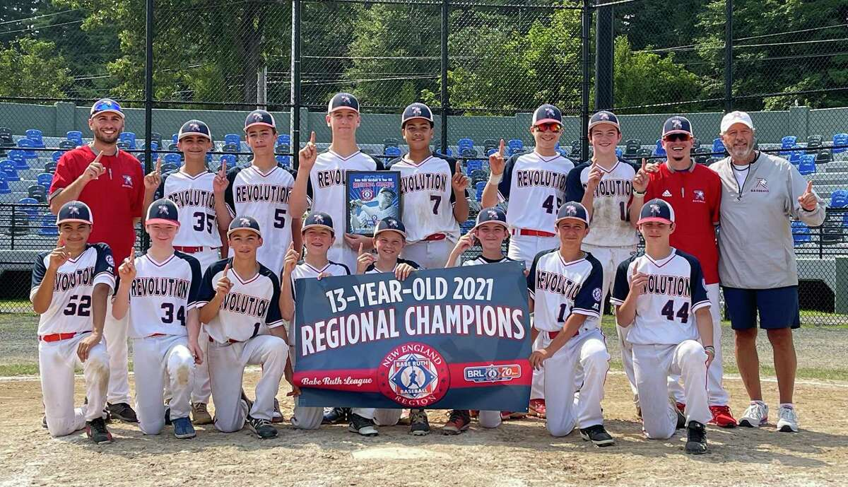 The Norwalk Revolution 13U baseball team poses for a team photo after winning the 2021 New England Regionals in Westfield, Mass.