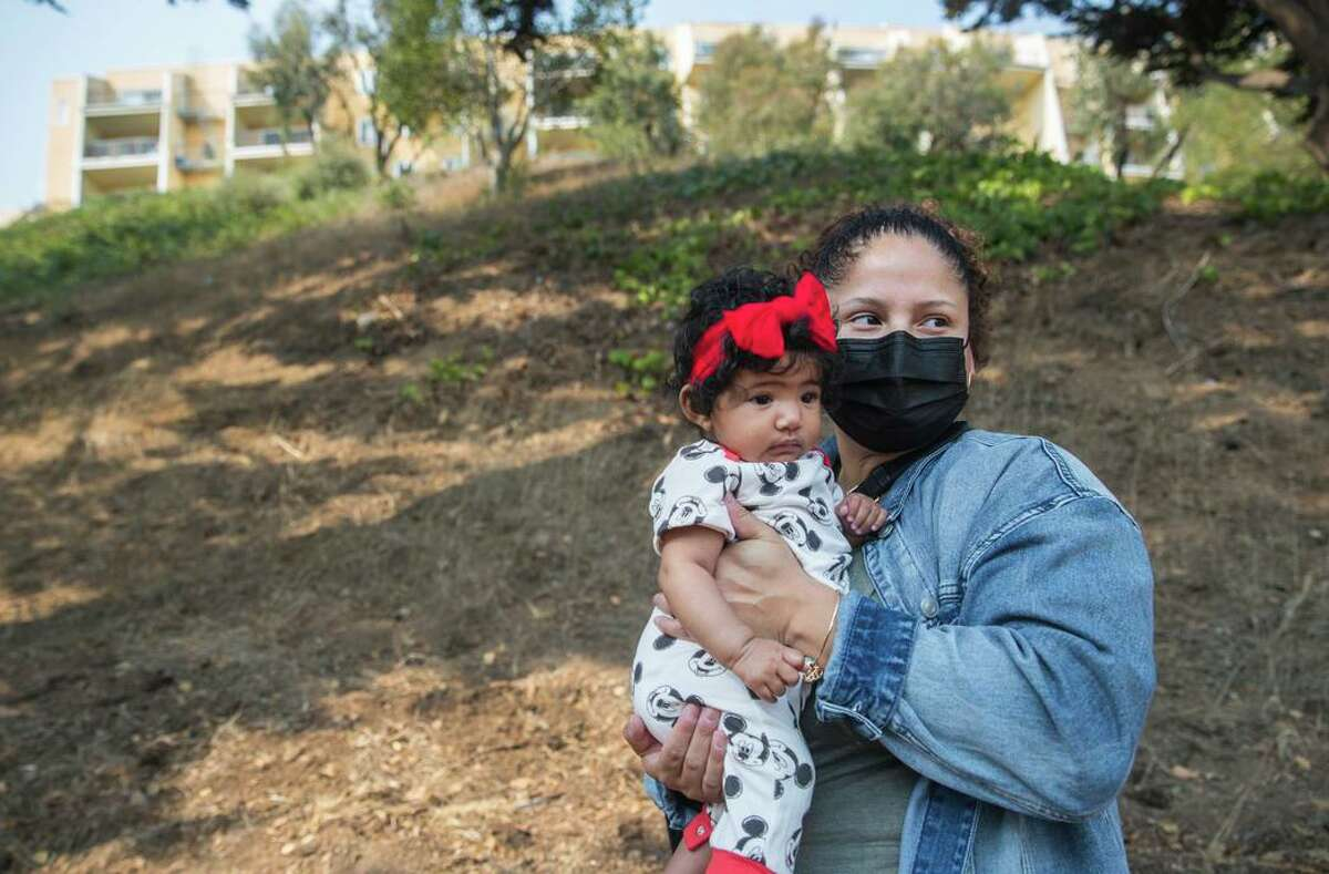 Rosa Baltobano, poses for a portrait with her daughter Sofia. Baltobano has been a resident in the Diamond Heights neighborhood since the '90s. She opposes the controversial proposal to build 24 townhomes on the hillside next to the affordable housing where she lives with her family.