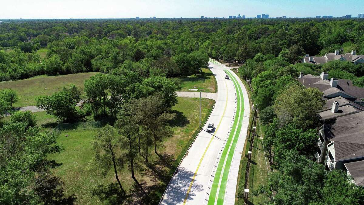 Pedestrian routes and bike lanes such as this one on Deerwood Drive would be a better investment for TXDOT than I-45 expansion, the author says.