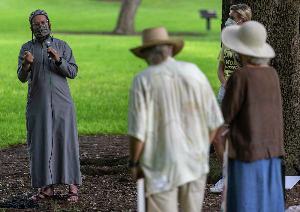 """Imam Islam Mossaad, left, speaks Monday afternoon, Aug. 30, 2021 on the grounds of the Texas capitol during an event organized by the Texas Poor People's Campaign to protest the """"carelessness of our elected officials,"""" according to a press release sent out by the group. The group says the event was the start of a series of they are calling Moral Mondays."""