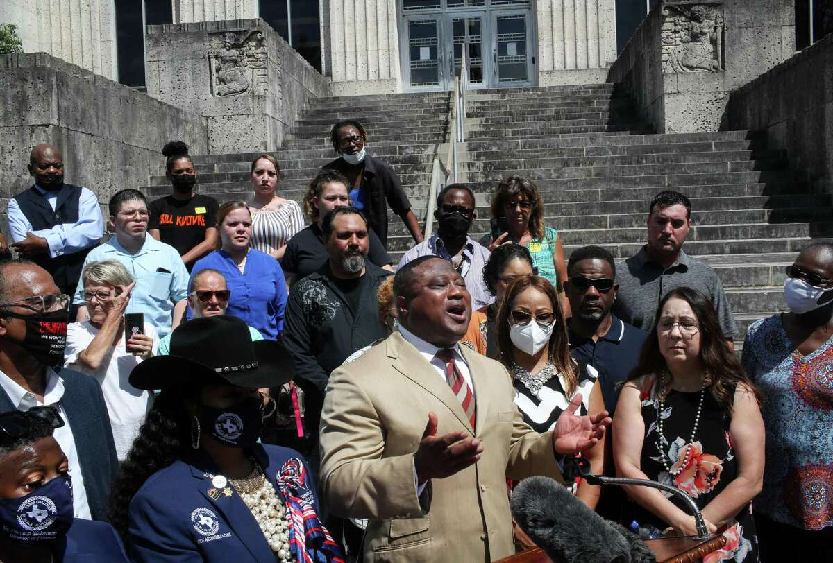 Quanell X, center, speaks during a press conference Monday, Aug. 30, 2021, at the Brazoria County Courthouse in Angleton. The Brazoria County District Attorney's Office and Texas Rangers Public Integrity Unit are investigating allegations that the district clerk's office, until last week led by Rhonda Barchak, improperly conducted juror selection. Families affected by the alleged misconduct gathered on the steps of the courthouse to call for a federal investigation.