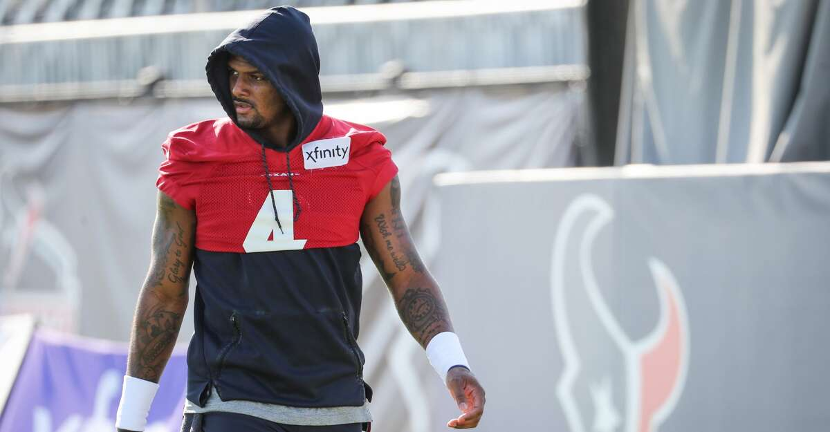"""Houston Texans quarterback Deshaun Watson walks to the field during an NFL training camp football practice Thursday, Aug. 12, 2021, in Houston. Watson commented as he passed the group of media members shooting photos of him as he walked past, """"Why are you all always filming me every day? It's the same (...)"""""""