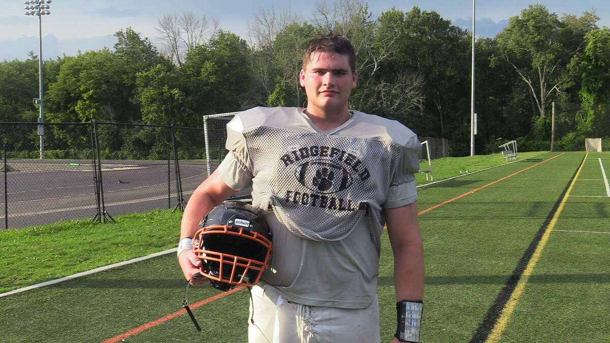 Ridgefield High School football player Cameron Smith poses for a portrait on Monday.