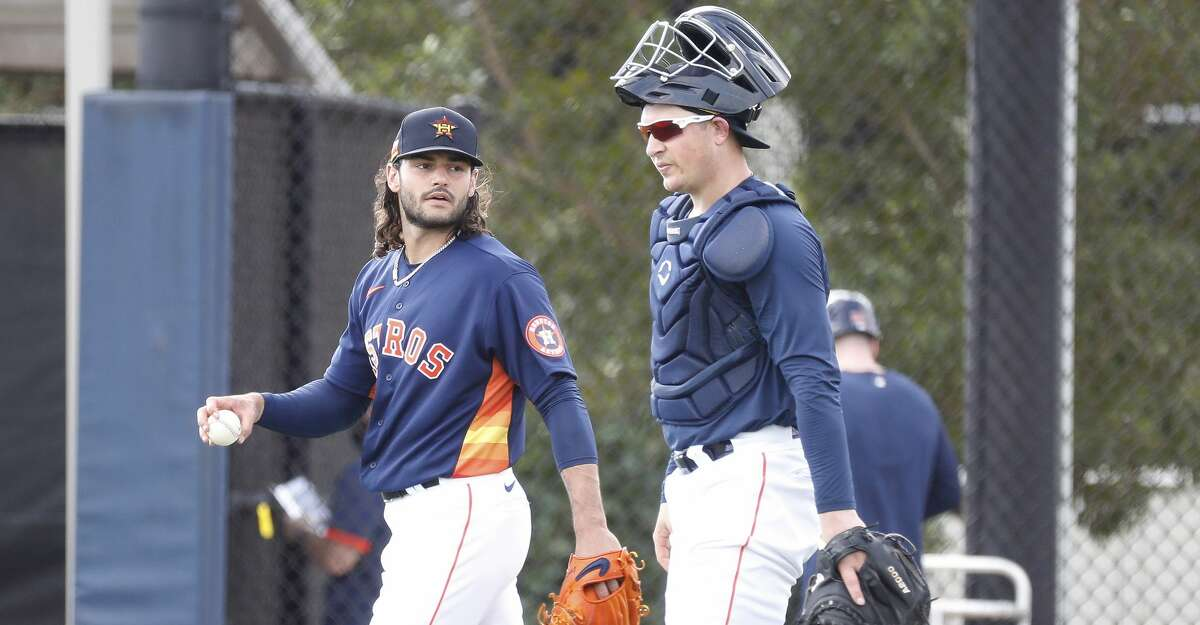 Houston Astros pitcher Lance McCullers Jr. (43) talks with catcher Michael Papierski (74) after his live BP session during spring training workouts for the Astros at Ballpark of the Palm Beaches in West Palm Beach, Florida, Saturday, February 27, 2021.