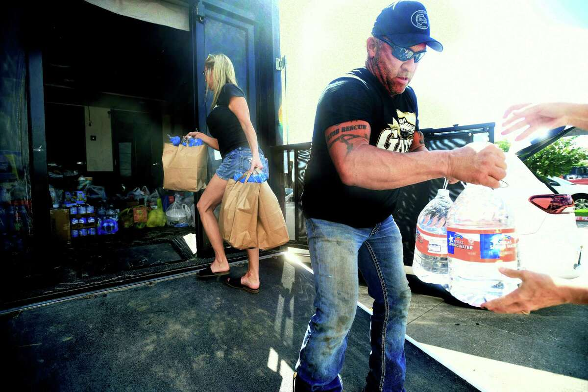 Shannon and Gary Saurage unload donations from a woman's vehicle outside Madison's on Dowlen as Southeast Texans help those in Louisiana impacted by Hurricane Ida. Photo made Monday, August 30, 2021 Kim Brent/The Enterprise