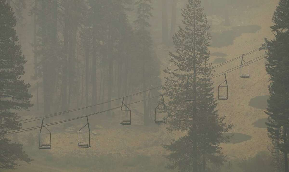 Heavy smoke from the Caldor Fire can be seen at Sierra-at-Tahoe ski resort in Twin Bridges on Monday.