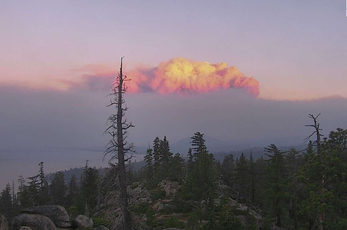 The huge plume of the Caldor Fire looms over the sunset near South Lake Tahoe on Aug. 30, 2021.