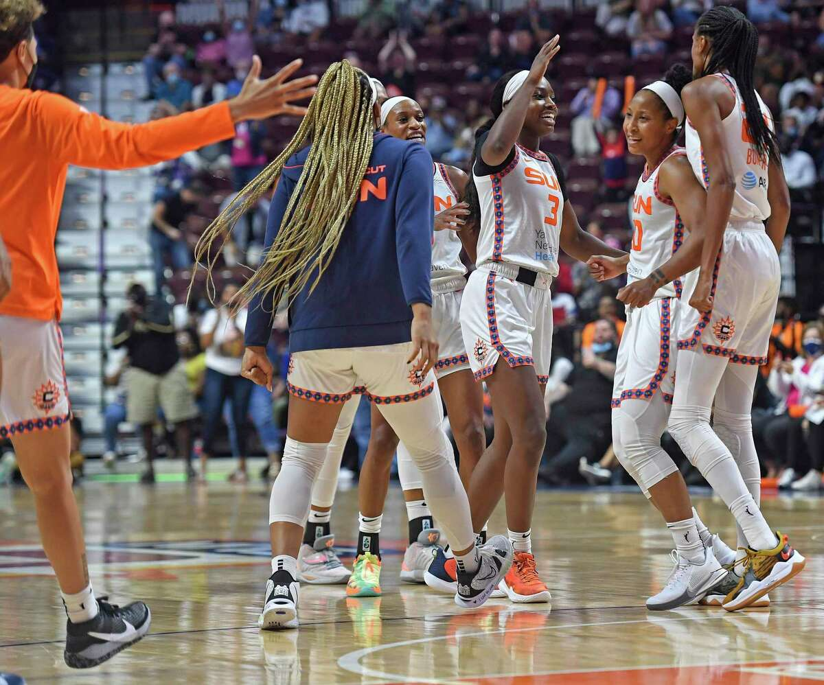 Connecticut Sun players celebrate a run, after the Los Angeles Sparks called for a timeout in a WNBA basketball game Saturday, Aug. 28, 2021, in Uncasville, Conn.