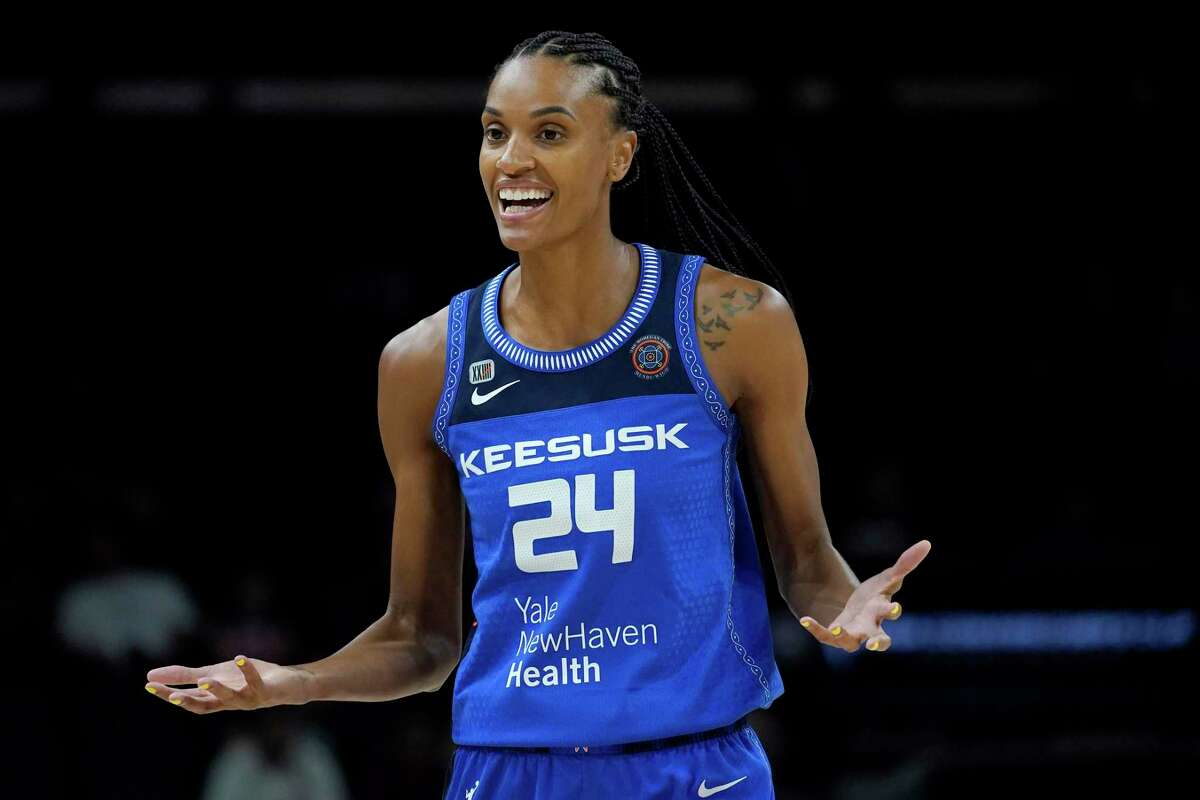 Connecticut Sun forward DeWanna Bonner (24) reacts towards the referee after a turn over during the first half of the Commissioner's Cup WNBA basketball game against the Seattle Storm, Thursday, Aug. 12, 2021, in Phoenix.