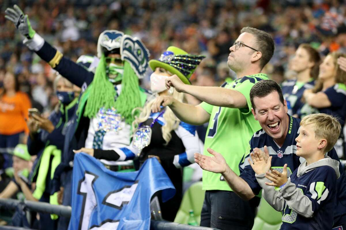 SEATTLE, WASHINGTON - AUGUST 21: Fans cheer during an NFL preseason game between the Seattle Seahawks and the Denver Broncos at Lumen Field on August 21, 2021 in Seattle, Washington. The Denver Broncos beat the Seattle Seahawks 30-3. (Photo by Steph Chambers/Getty Images)