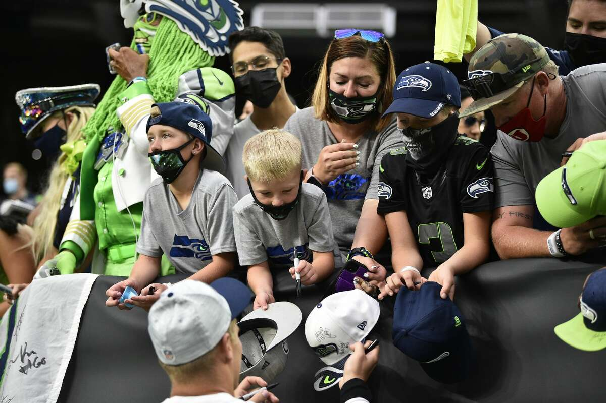 LAS VEGAS, NEVADA - AUGUST 14: Seattle Seahawks fans ask for autographs before a preseason game against the Las Vegas Raiders at Allegiant Stadium on August 14, 2021 in Las Vegas, Nevada. (Photo by Chris Unger/Getty Images)