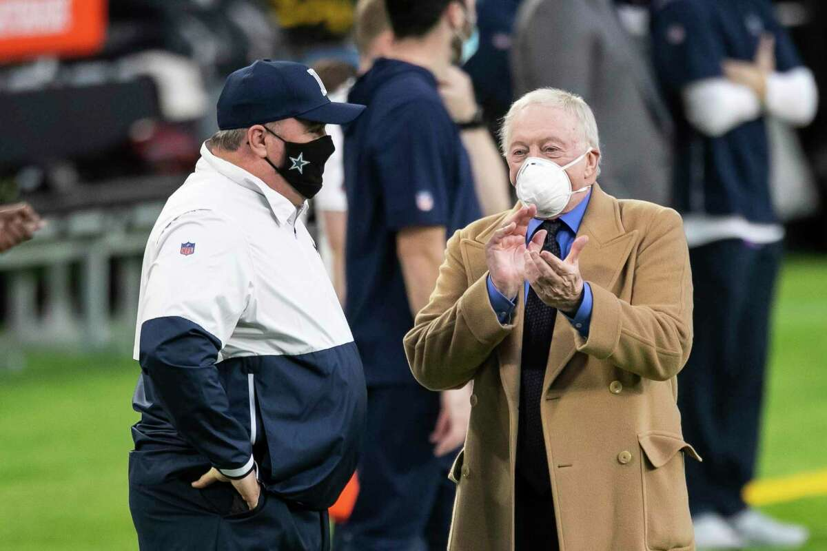 Cowboys owner Jerry Jones talks to head coach Mike McCarthy before a game against the Vikings on Nov. 22, 2020 in Minneapolis.