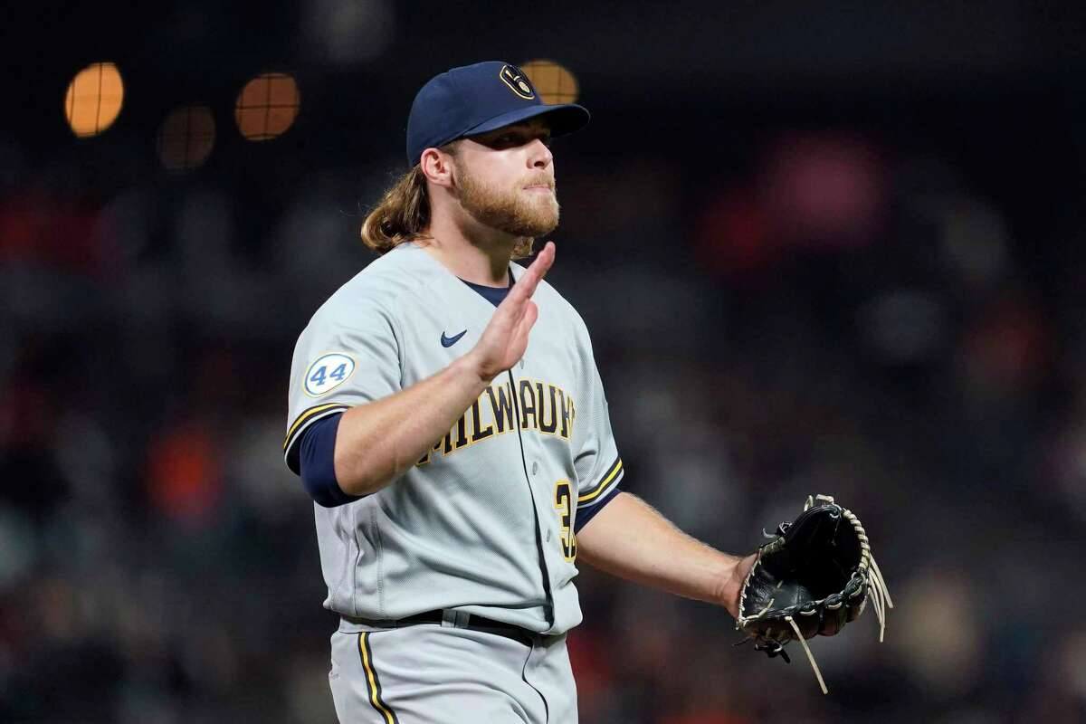 Corbin Burnes reacts after striking out Buster Posey to end the sixth inning Monday.