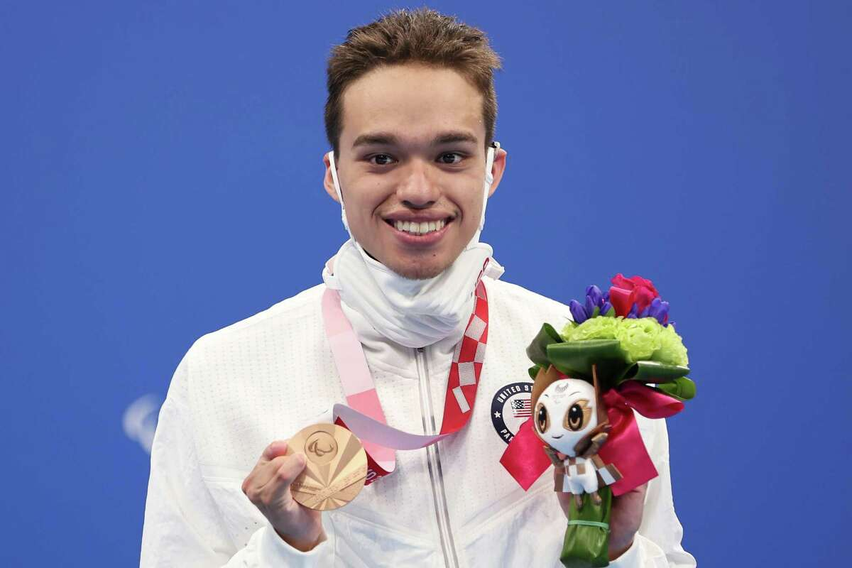 TOKYO, JAPAN - AUGUST 31: Matthew Torres of Team United States celebrates with the bronze medal during the medal ceremony for the Men's 400m Freestyle - S8 Final on day 7 of the Tokyo 2020 Paralympic Games at Tokyo Aquatics Centre on August 31, 2021 in Tokyo, Japan. (Photo by Lintao Zhang/Getty Images)