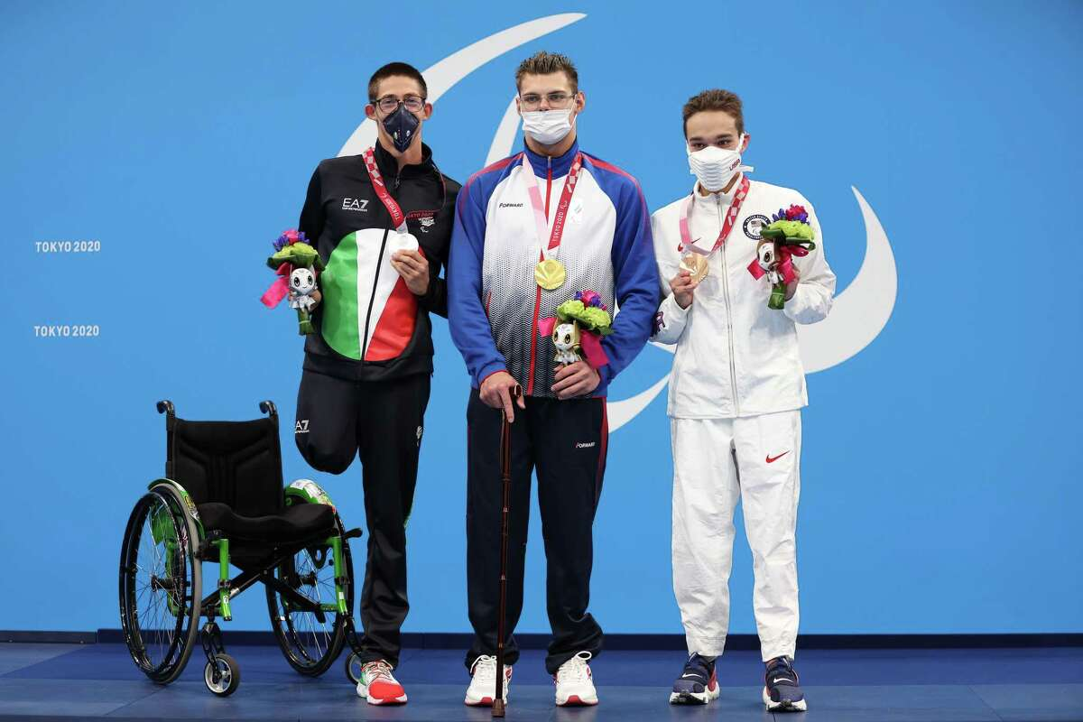 Silver medalist Alberto Amodeo of Italy, gold medalist Andrei Nikolaev of the Russian Paralympic Committee and bronze medalist Matthew Torres of the United States celebrate during the medal ceremony for the Men's 400-meter Freestyle-S8 Final at the 2020 Paralympic Games at Tokyo Aquatics Centre on Tuesday.