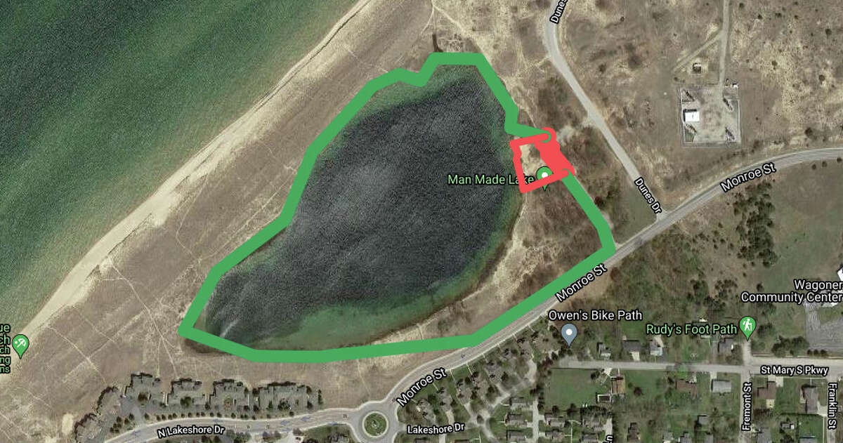 This google map shows the area in red as the private 0.33 acre (120 feet by 120 feet) parcel and the green surrounding it as land owned by the city of Manistee.