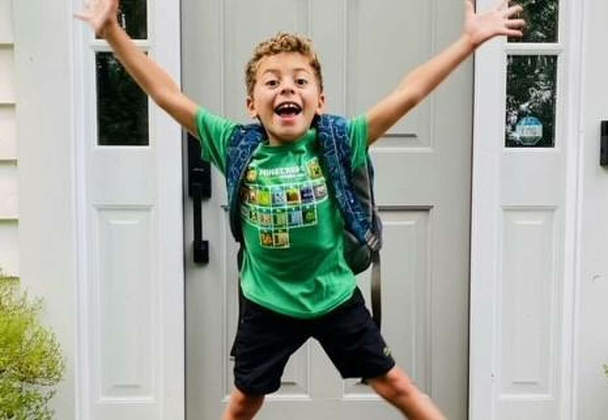 Romeo Sacripanti, a second grader at New Canaan West School, expressed his excitement about going back to school.