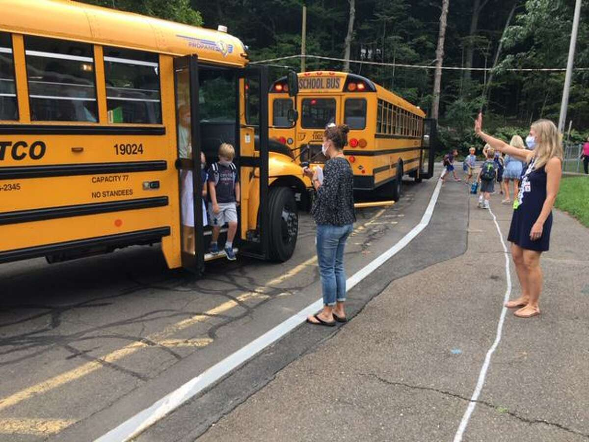 Students were wearing masks as they got off the bus at East School in New Canaan on their first day Sept. 2, 2021.