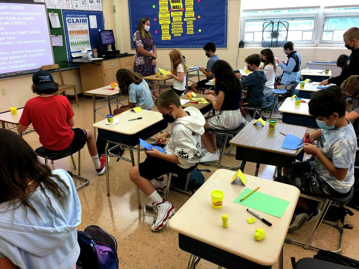 Students were wearing masks as they got to work at Saxe Middle School in New Canaan on their first day Sept. 2, 2021.
