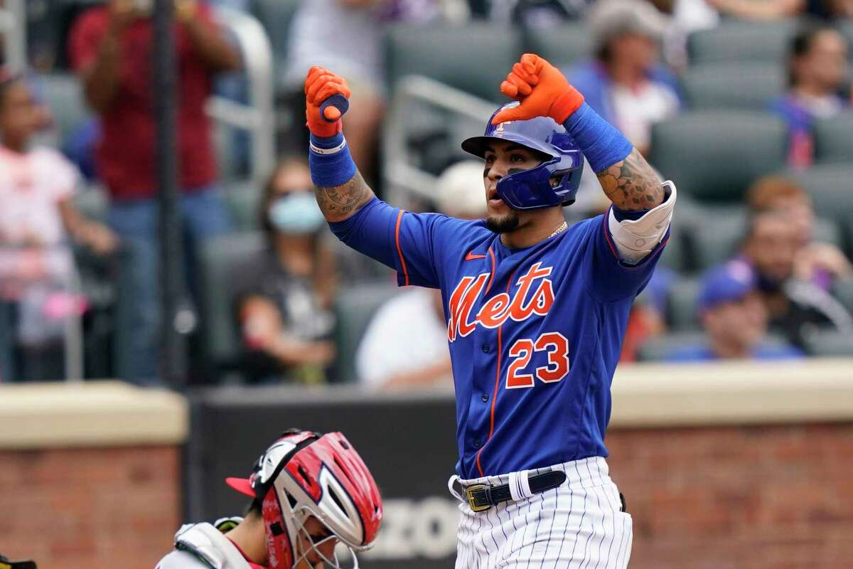 New York Met Javier Baez gestures at home plate after his two-run home run that also scored Michael Conforto during the fourth inning of a baseball game against the Washington Nationals, Sunday, Aug. 29, 2021, in New York.