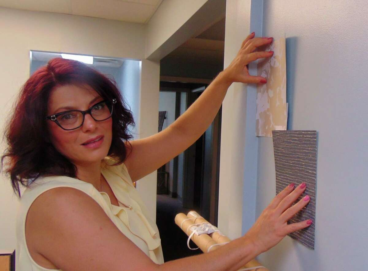 Owner Dina Velocci displayed samples for the walls. (Star photo/Shanna Avery)