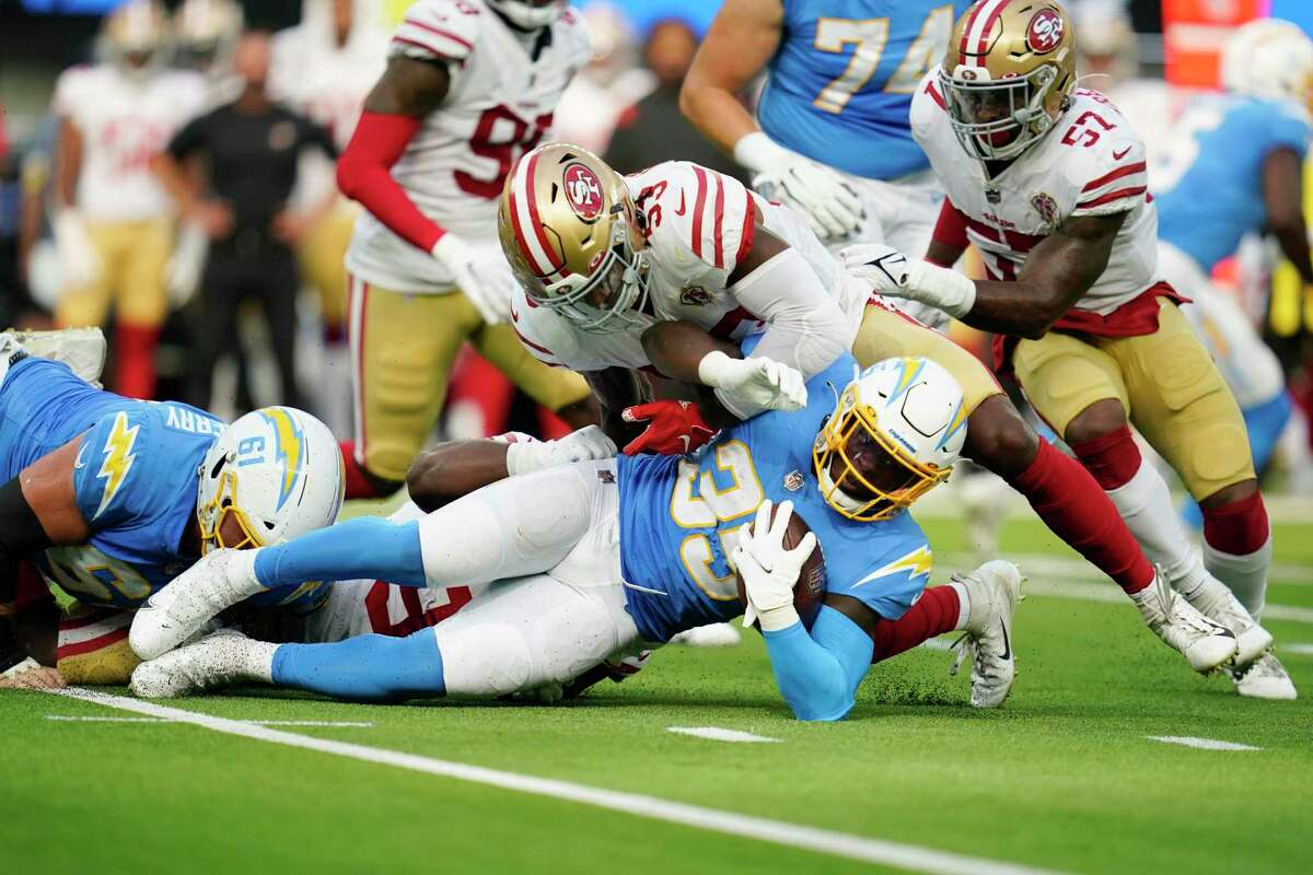 Los Angeles Chargers running back Larry Rountree III, bottom, is tackled by San Francisco 49ers linebacker Jonas Griffith (53) during the first half of a preseason NFL football game Sunday, Aug. 22, 2021, in Inglewood, Calif. (AP Photo/Ashley Landis)