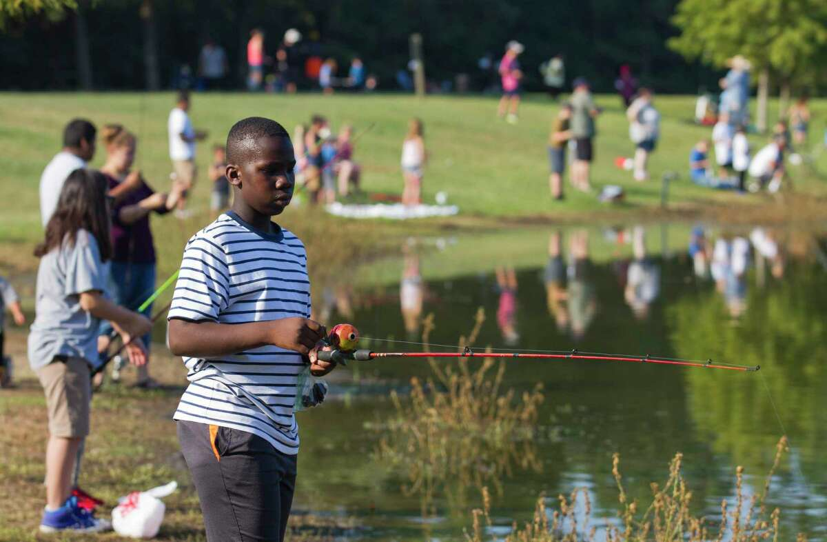 Alex Zee takes part in the annual KidFish event at Carl Barton, Jr. Park, Saturday, Sept. 14, 2019, in Conroe. The event helped kids gain an appreciation for fishing as well as awareness for the environment and natural resources. This year's event is Saturday from 9 a.m. to noon.