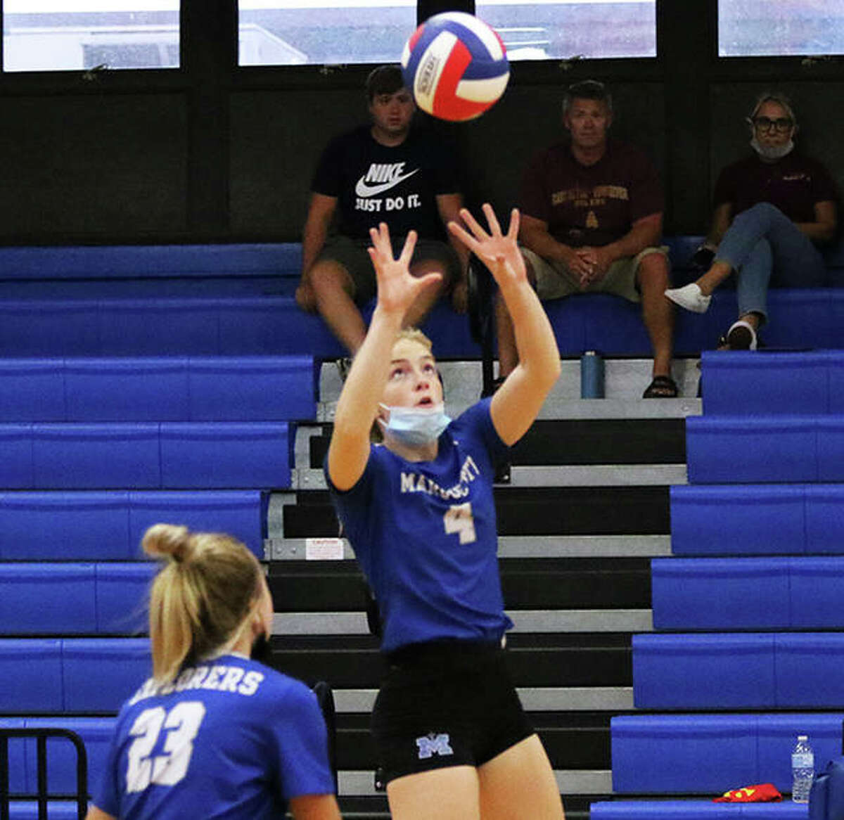 Marquette Catholic's Allison Geiger (4) pushes the ball over the net in a match last week at the Roxana Tourney. On Monday, Geiger had a team-high five kills in the Explorers' win at Maryville Christian.