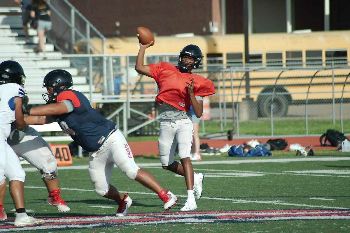 Dawson quarterback Colin Johnson and the rest of the Eagles try to earn a win Friday against Houston Heights at The Rig in Pearland.