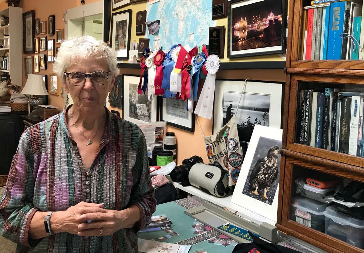 Connie Frisbee Houde, 73, a member of Women Against War, who took thousands of photographs during five extended trips to Afghanistan, is skeptical of U.S. interventions around the world.