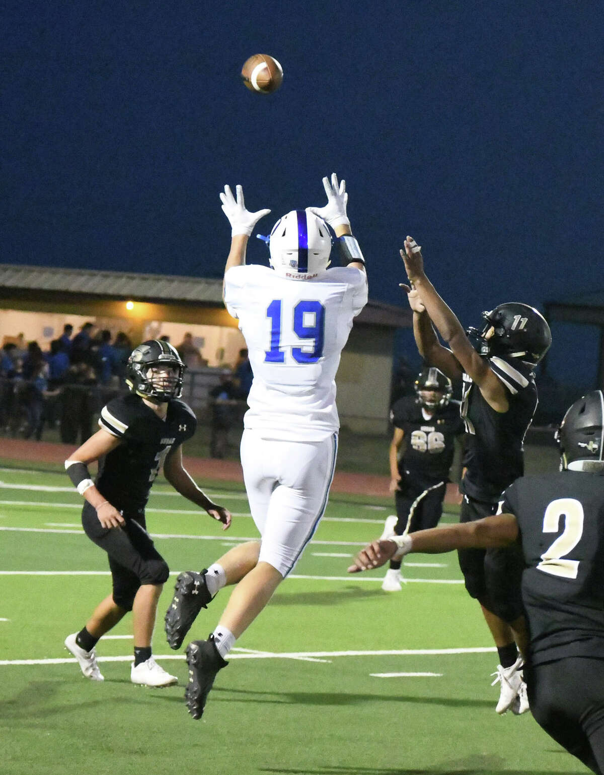 Olton junior wide receiver, Brennon Huguley, goes up for a catch between two Sudan defenders, during the third quarter of Fridays contest with the Sudan Hornets in their season-opener