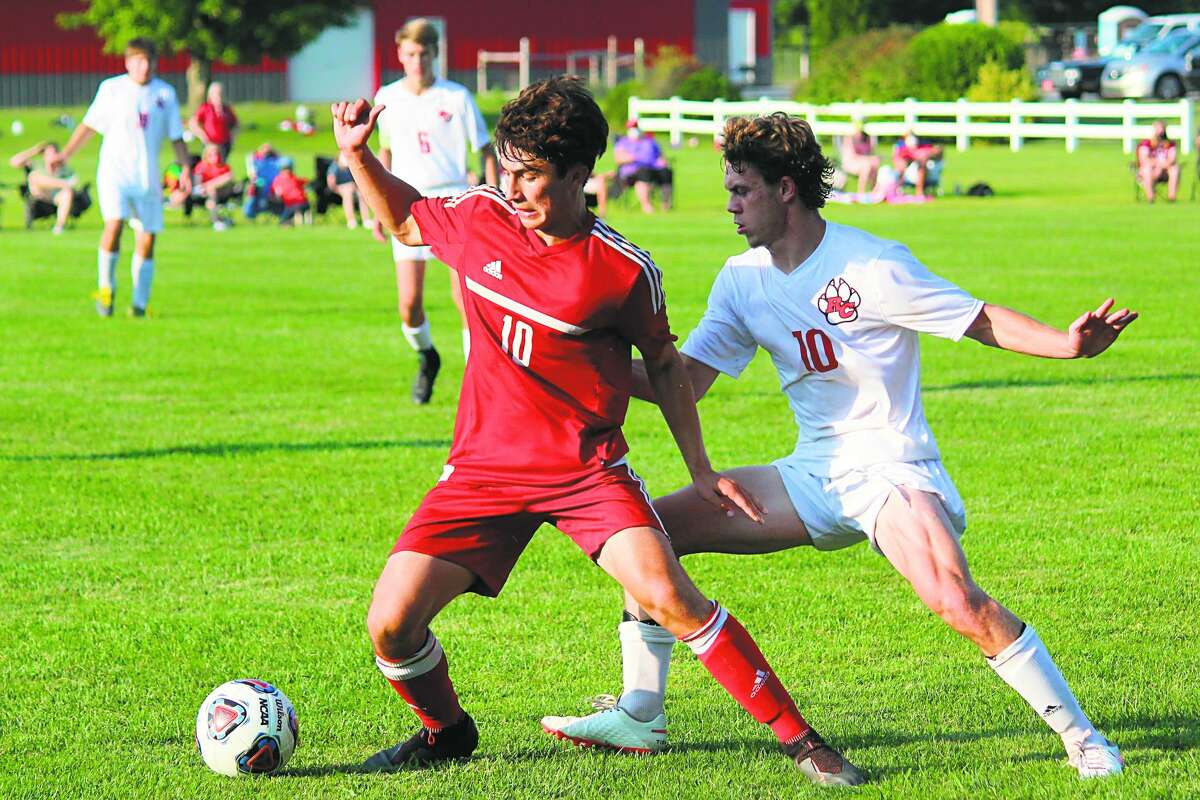 Kevin Hubbell uses his craft to corral the ball away from the Reed City defender before making his move.