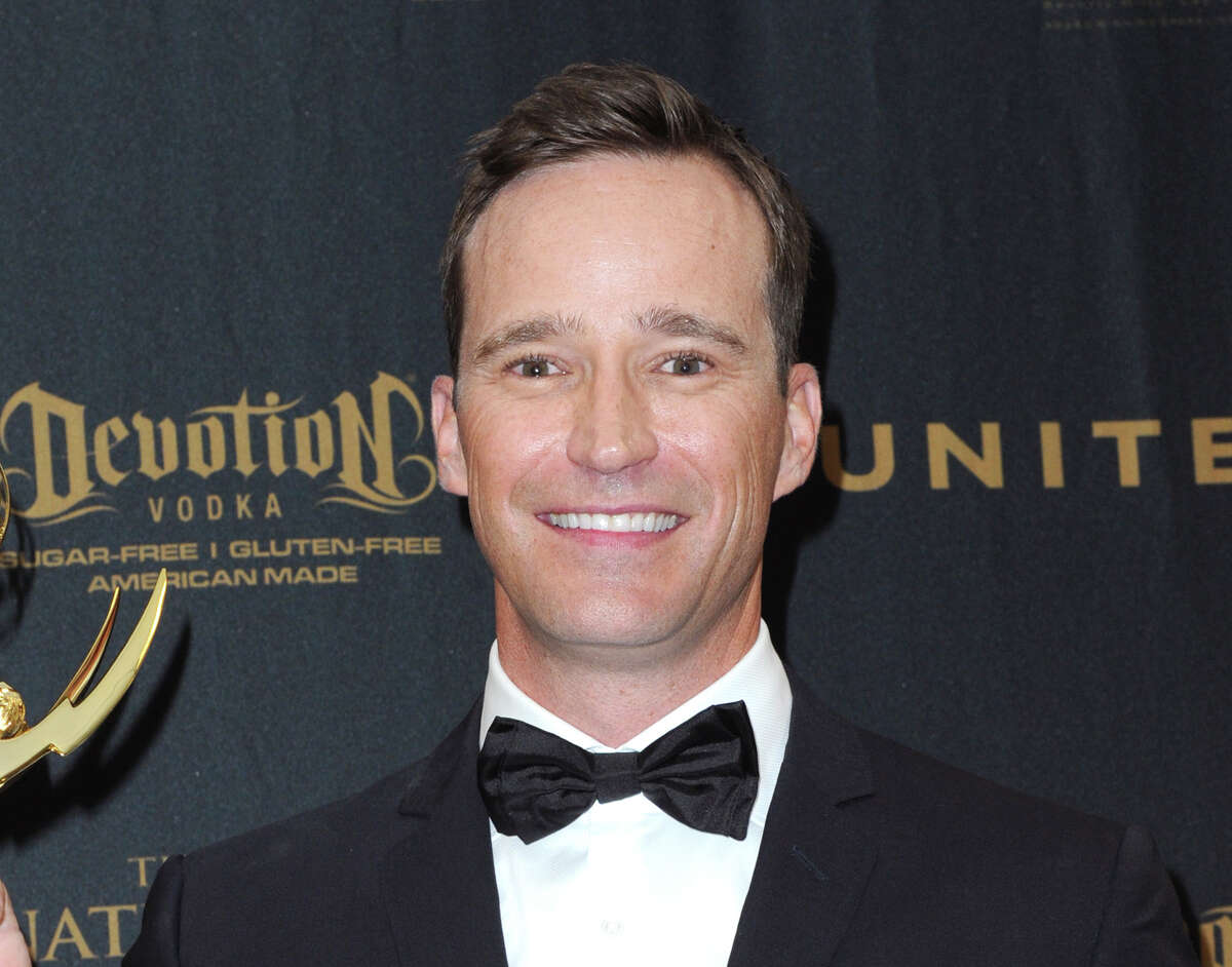 FILE - Producer Mike Richards poses in the pressroom at the 43rd annual Daytime Emmy Awards on May 1, 2016, in Los Angeles. Richards is out as executive producer of