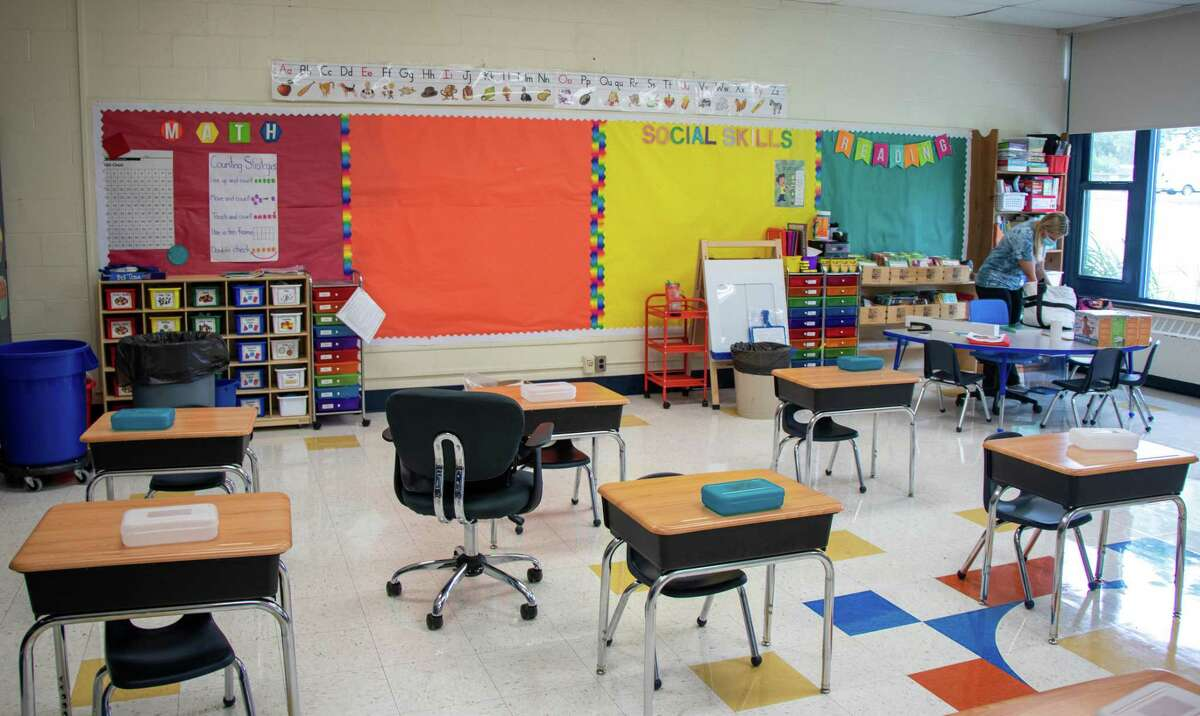 Sara Calechnan gets her classroom ready for students who begin instruction on Wednesday.