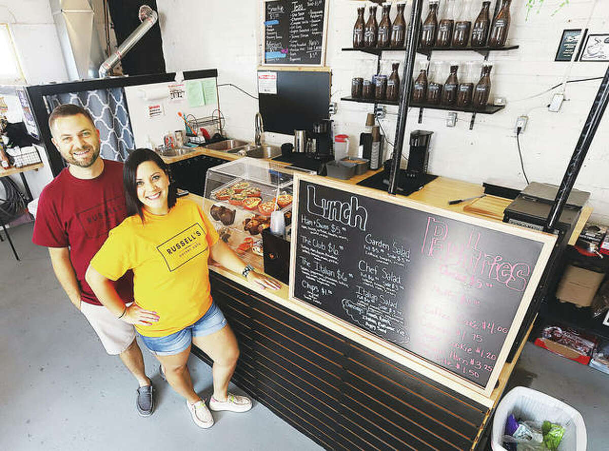 Katie and Andrew Russell stand inside their business, Russell's Corner Cafe, at 84 E. Ferguson Ave. in Wood River. The establishment will celebrate its one-year anniversary in business on Sept. 4.