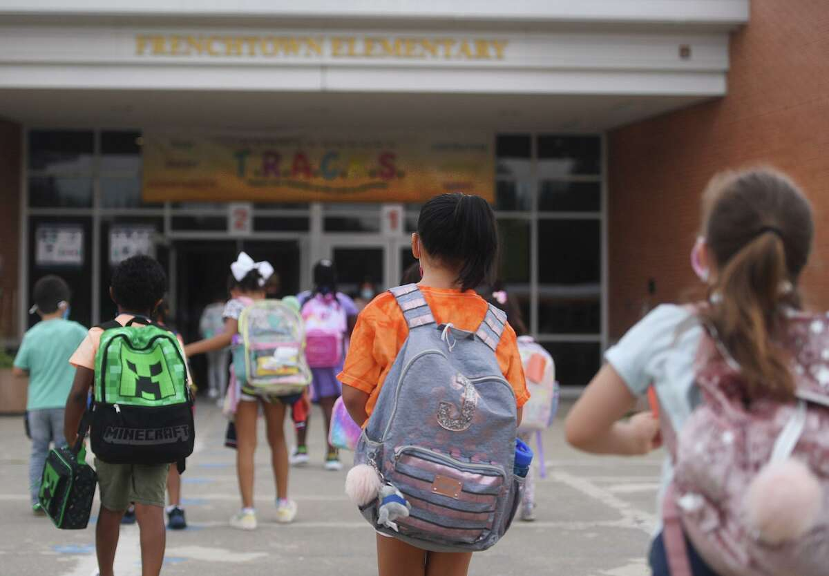 Students return for the first day of school at Frenchtown Elementary School on Tuesday.
