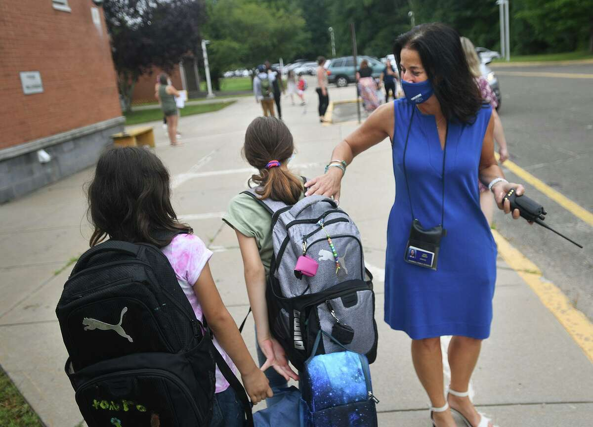 Principal Gina Prisco welcomes back students for the first day of school at Frenchtown Elementary School in Trumbull on Tuesday, August 31.